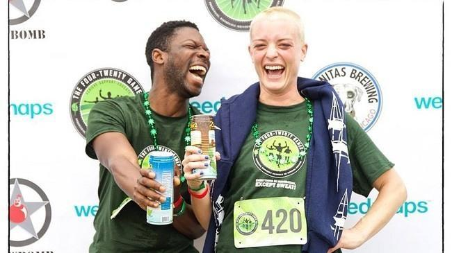 Two race participants celebrate their finish at the Saturday 4.2-mile race. Image: 420 Games via MarketWatch