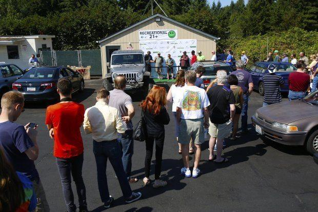 When Herbal Nation opened in Bothell, a line of about 75 people weaved through its parking lot to buy marijuana.