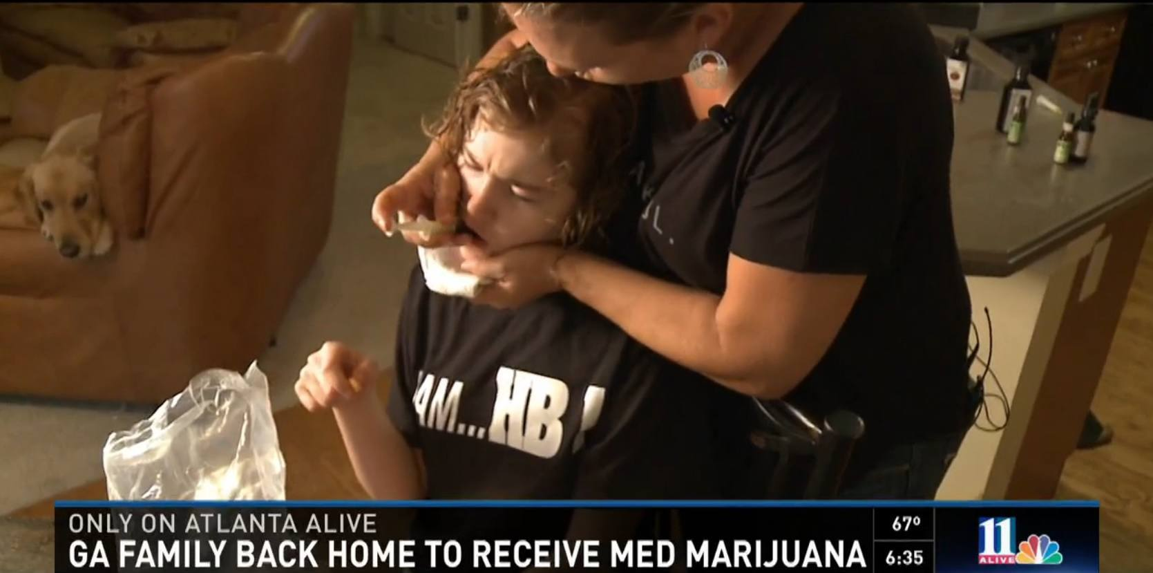 Image of Corey Lowe giving her daughter CBD Oil for her seizures