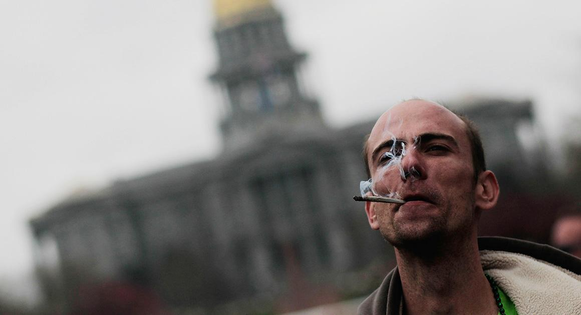 Image of man smoking pot in front of US Capitol