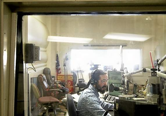 Christopher Carr broadcasts The Cannabis Connection live at KSCO 1080 AM on Friday nights. (Shmuel Thaler -- Santa Cruz Sentinel)