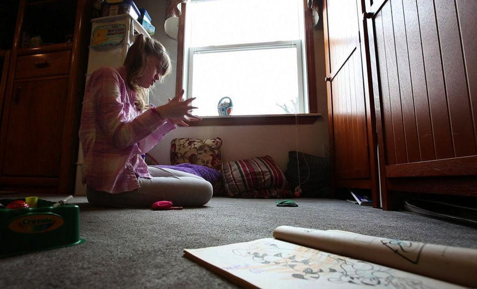 image of Genny Barbour playing in her living room. 4/10/14 Maple Shade, NJ (John Munson | NJ Advance Media for NJ.com)