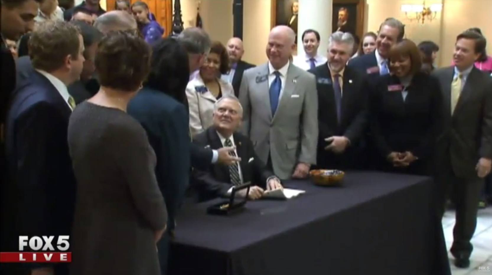 Image of Georgia Governor Nathan Deal signing a bill to leagalize Maedical Marijuana