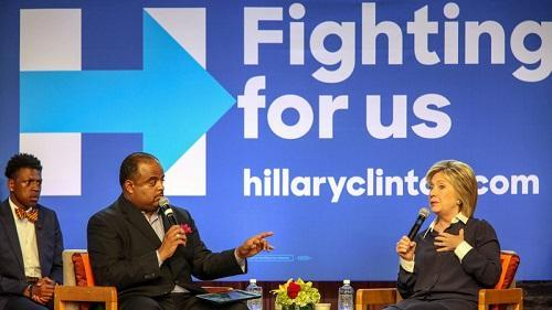 Democratic presidential candidate Hillary Clinton responds to a question from Roland Martin, host of TV One's News One Now, during a town hall meeting at Claflin University in Orangeburg, S.C. Image: Richard Burkhart/AP Images for TV One via NPR.org