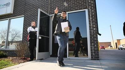 Chris Favela, who has multiple sclerosis, is the first recipient of medical marijuana at a dispensary in Addison, Illinois on November 9. Image: Stacey Wescott, Chicago Tribune