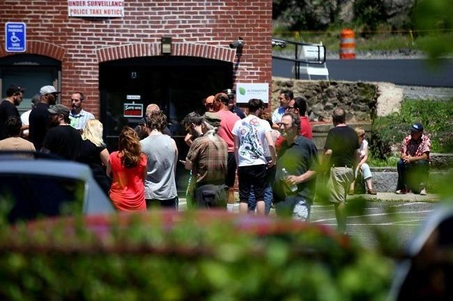 Customers waited for the first medical marijuana dispensary in Massachusetts to open in Salem, on June 24. Image: Jonathan Wiggs/Globe Staff