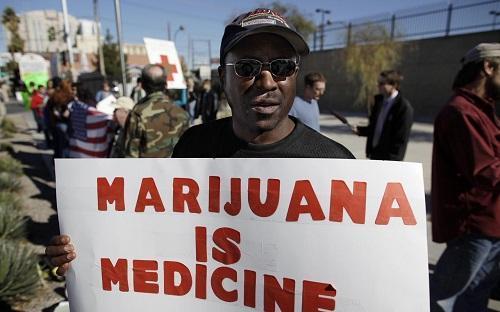 MarijuanaIsMedicineSignImageJulieJacobsonAPViaLeaflyDotCom