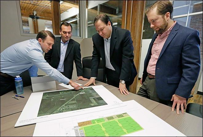 Image of medical marijuana investors making plans to build cannabis grow facilities
