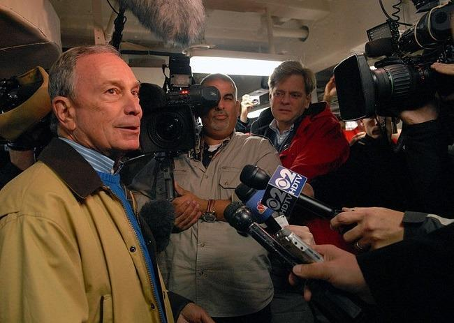Michael Bloomberg, then Mayor of New York, speaks to the media aboard the amphibious transport dock ship Pre-Commissioning Unit (PCU) New York (LPD 21) in Nov. 2009. Image: U.S. Navy via Wikimedia Commons