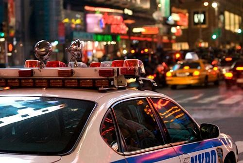 NYPD in Times Square. Image: William Hoiles via Wikimedia Commons.