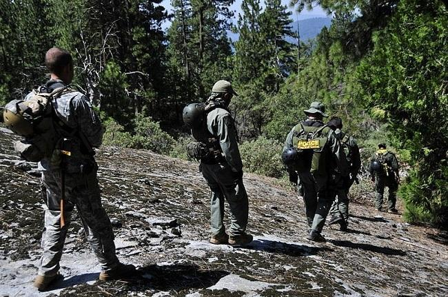 A multi-agency team supporting Operation Trident, a large-scale marijuana eradication and reclamation mission, in 2010. Image: U.S. Army National Guard via Wikimedia Commons