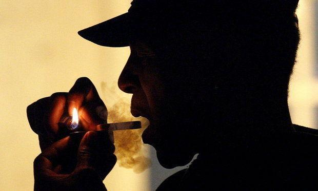 2011 file photo of an unidentified man smokes medical marijuana during karaoke night at the Cannabis Cafe, in Portland, Ore. At a July 3 event, Weed the People, people will gather to smoke legally and receive free marijuana from Oregon growers. (AP Photo)
