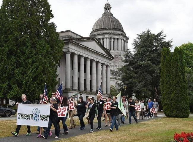 Veterans and their supporters march in Olympia to raise awareness of veterans PTSD and suicide issues. Steve Bloom/Staff Photographer