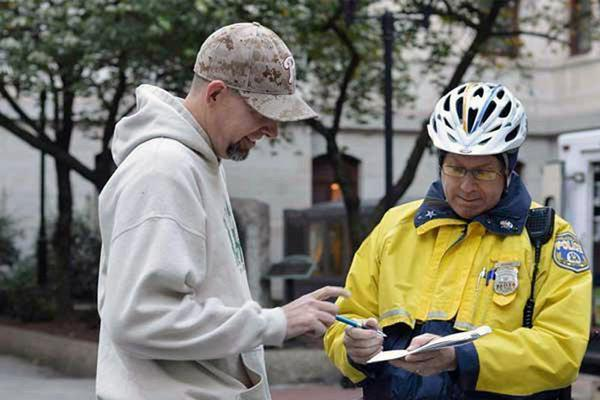 Mike Whiter receives the first citation for rolling up a joint at City Hall. Image: Mike Whiter via Philly.com