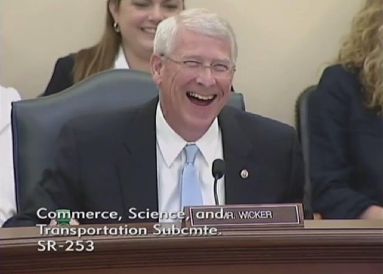 Image of Roger Wicker laughing and Cory Gardner's joke