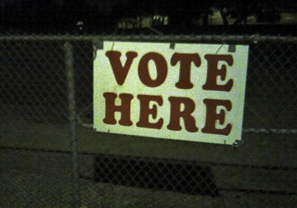 Voting sign at night. Image: Ben Combee, Austin TX via Wikimedia Commons