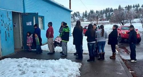Members of the Confederated Tribes of Warm Springs stand in line Thursday, Dec. 17, waiting to vote on a cannabis cultivation referendum. Image via Jefferson Public Radio