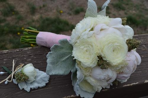 A wedding bouquet of peonies and cannabis buds. Image via BudsandBlossomsco.com