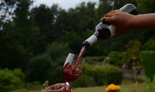 WineBeingPouredImageRajStevensonViaWikimediaCommons