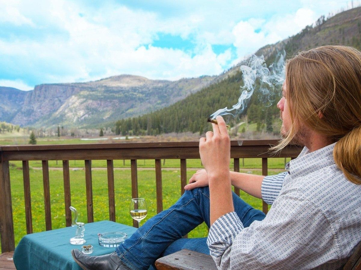 Image of a Colorado vacationer enjoying legal recreational marijuana at a resort near Durango.