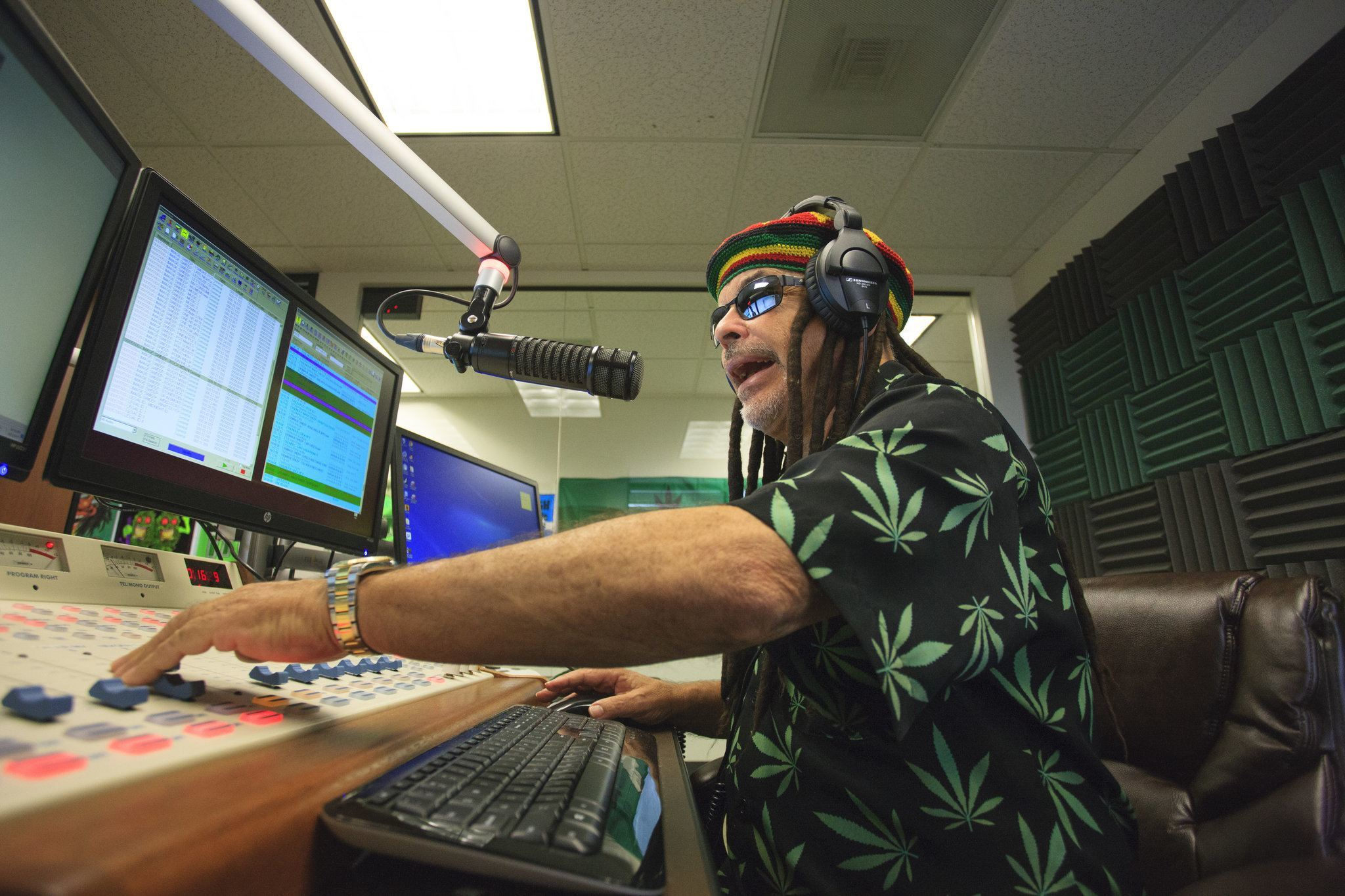 Image of Marc Paskin, who goes by the name Gary Ganja, on the air in the Smokin 94.1 studio in Denver. Credit Matthew Staver for The New York Times